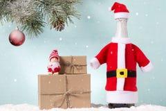 Tarjeta de Navidad Juguete de la Navidad y un topetón en abeto Foto de archivo