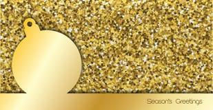 Tarjeta de Navidad simple con la chuchería del oro Imagen de archivo libre de regalías