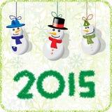 Tarjeta de Navidad verde con los muñecos de nieve 2015 Fotos de archivo libres de regalías