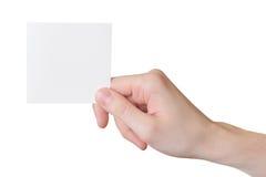 Tarjeta de papel en mano del hombre Foto de archivo libre de regalías