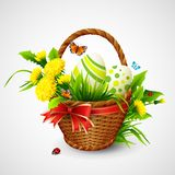 Tarjeta de pascua con la cesta, los huevos y las flores Vector