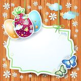 Tarjeta de pascua con la etiqueta y los huevos Foto de archivo libre de regalías