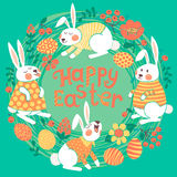 Tarjeta de pascua feliz con los conejitos lindos y coloreada Foto de archivo libre de regalías