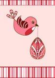 Tarjeta de pascua. Pájaro con el huevo.