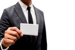 Tarjeta de presentación de la demostración del hombre de negocios con el fondo blanco Imagen de archivo libre de regalías