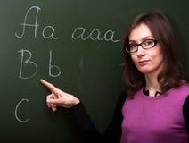 Tarjeta de tiza del ABC del profesor de la mujer Fotos de archivo libres de regalías