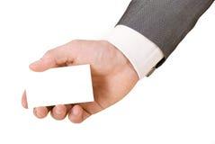 Tarjeta de visita en blanco en una mano Imagen de archivo libre de regalías