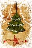 Tarjeta del árbol de navidad del vintage con los copos de nieve Fotografía de archivo