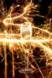 Tarjeta del Año Nuevo con el vidrio del champán Fotografía de archivo
