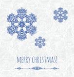 Tarjeta del Año Nuevo con los copos de nieve y el elemento azules del diseño ilustración del vector