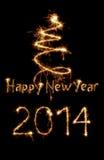 Tarjeta del Año Nuevo 2014 escrita con las chispas Foto de archivo libre de regalías