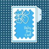 Tarjeta del bebé en un fondo azul con los puntos Foto de archivo libre de regalías