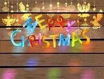 Tarjeta del color de la Feliz Navidad con ángeles Foto de archivo libre de regalías