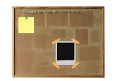 Tarjeta del corcho con la polaroid Imagen de archivo