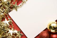 Tarjeta del día de fiesta con las estrellas del oro Imagenes de archivo