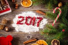 Tarjeta del día de fiesta por la Navidad o el Año Nuevo 2017 Imagenes de archivo