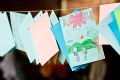 Tarjeta del día de madre, schoolwork del cabrito imágenes de archivo libres de regalías