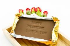 Tarjeta del día de San Valentín feliz etiquetada chocolate te quiero Foto de archivo