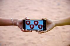 Tarjeta del día de San Valentín móvil del corazón para el día feliz Imagen de archivo