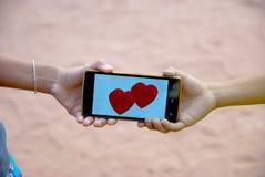 Tarjeta del día de San Valentín móvil del corazón para el día feliz Imagen de archivo libre de regalías