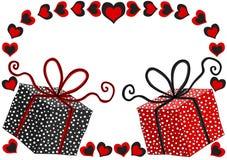 Tarjeta del día de tarjetas del día de San Valentín con las cajas de regalo Foto de archivo libre de regalías