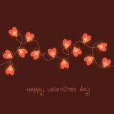 Tarjeta del día de tarjetas del día de San Valentín con las luces rojas Foto de archivo libre de regalías