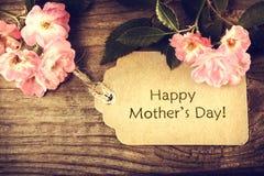 Tarjeta del día de madres con las rosas Foto de archivo libre de regalías