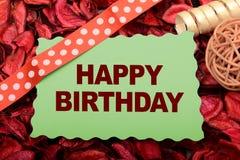 Tarjeta del feliz cumpleaños con el fondo de la decoración de la cinta Imagenes de archivo