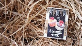 Tarjeta del feliz cumpleaños en el heno Imágenes de archivo libres de regalías