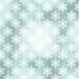 Tarjeta del invierno con los copos de nieve en un fondo de la Navidad Fotos de archivo libres de regalías