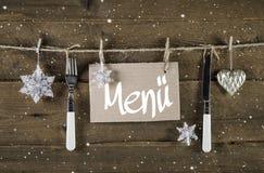 Tarjeta del menú de la Navidad para los restaurantes con el cuchillo y la bifurcación en woode Imágenes de archivo libres de regalías