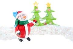 Tarjeta del muñeco de nieve de la Navidad Fotos de archivo
