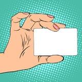 Tarjeta del negocio o de crédito en mano femenina ilustración del vector