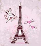 Tarjeta del vintage con la torre Eiffel y el cupido Foto de archivo libre de regalías