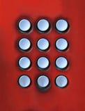 Tarjeta dominante del botón del número en telepho público Fotos de archivo libres de regalías