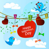 Tarjeta el día de San Valentín con el corazón y los pájaros azules Foto de archivo libre de regalías