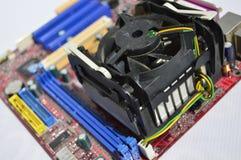 Tarjeta electrónica de la PC, disipador de calor y ventilador Imagenes de archivo