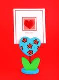Tarjeta en blanco con el corazón rojo Fotografía de archivo