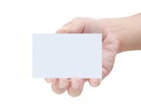 Tarjeta en blanco en una mano masculina Imagen de archivo