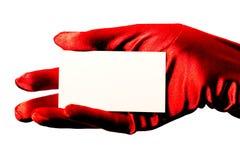 Tarjeta en blanco y guante rojo Imagenes de archivo