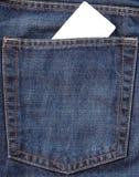 Tarjeta en bolsillo de los pantalones vaqueros Fotos de archivo libres de regalías
