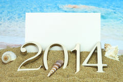tarjeta 2014 en la playa Imagen de archivo libre de regalías
