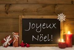 Tarjeta festiva, pizarra, nieve, Joyeux Noel Mean Merry Christmas Fotografía de archivo libre de regalías