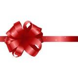 Tarjeta hermosa con el arco y la cinta rojos del regalo Imágenes de archivo libres de regalías