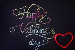 Tarjeta manuscrita del día de tarjetas del día de San Valentín con las letras coloridas Fotografía de archivo