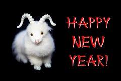 Tarjeta o postal de felicitación del Año Nuevo con la cabra Fotografía de archivo libre de regalías