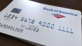 Tarjeta plástica con el logotipo de la Bank of America Representación conceptual editorial 3D stock de ilustración