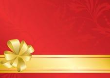 Tarjeta roja con el arqueamiento de oro - EPS Fotografía de archivo libre de regalías