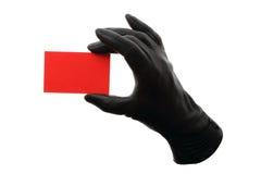 Tarjeta roja con los guantes de cuero negros imágenes de archivo libres de regalías