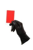 Tarjeta roja con los guantes de cuero negros foto de archivo libre de regalías